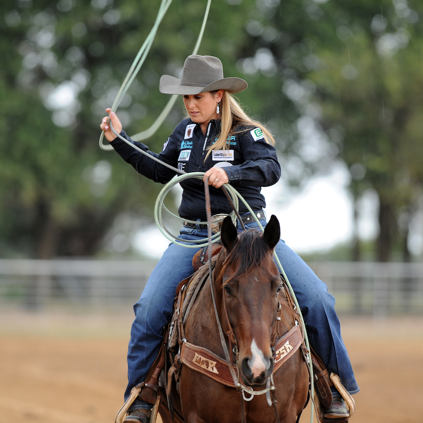 Jackie Crawford swings a rope aboard a new rope horse
