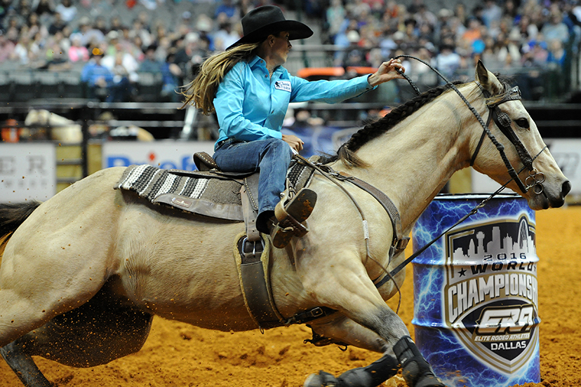 barrel racer on buckskin horse turns a barrel (Credit: Lone Wolf Photography)