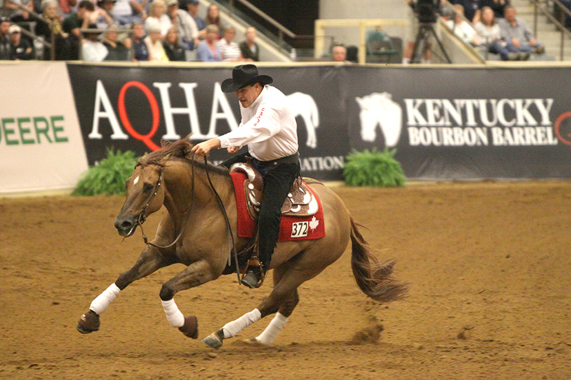 Duane Latimer competes in reining at the 2010 World Equestrian Games in Kentucky (Credit: AQHA)