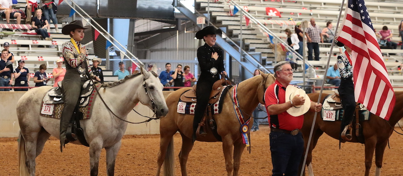 American Quarter Horse Youth World Cup horsemanship riders pledge allegiance to the flag on horseback during the awards ceremony