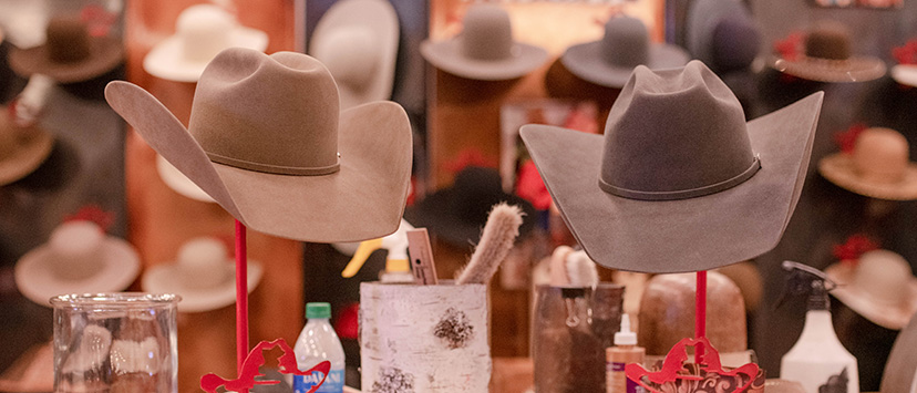 two cowboy hats sit on display at the Shorty's Caboy Hattery booth at the 2019 AQHA World Show Trade Show (Credit: Kirstie Marie Photography for AQHA)